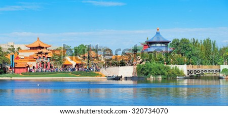 ORLANDO, FL - FEB 13: Disney Epcot park view over lake with foreign architecture on February 13, 2012 in Orlando, Florida. Epcot is the third most visited theme park in the US, and fifth in the world. - stock photo