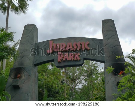 ORLANDO, FLORIDA APRIL 19th:  Entrance to the Jurassic Park area of Islands of Adventure, Universal Studios, Orlando Florida. on April 19th, 2014. - stock photo