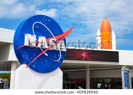 Orlando, Florida/USA April 10 2013: Kennedy space center museum NASA sign with a rocket on the background - stock photo