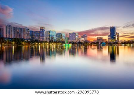 Orlando, Florida, USA downtown city skyline on Eola Lake. - stock photo