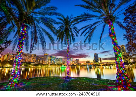 Orlando, Florida, USA downtown cityscape from Eola Lake. - stock photo