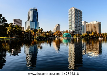 Orlando Lake Eola in the afternoon with urban skyscrapers and clear blue sky. - stock photo