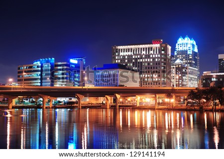Orlando Lake Lucerne panorama at night with office buildings, bridge - stock photo