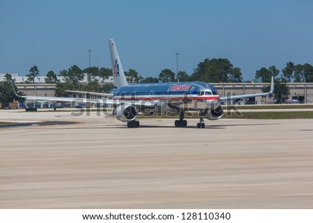 ORLANDO - SEPTEMBER 4: Boeing 767 American Airline lining up on Orlando Airport runway located in Orlando USA on September 4 2012. American Airline is one of the biggest and oldest airline in world - stock photo
