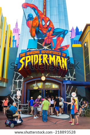 ORLANDO,USA - AUGUST 24, 2014 : Visitors entering the Spiderman ride at Universal Studios Islands of Adventure theme park - stock photo