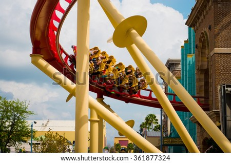 """ORLANDO, USA - MARCH 28: Unknown people have a good time on Roller coaster  in the most popular theme park of Orlando """"Universal Studios Orlando Florida"""" on March 28, 2014 in Orlando, USA - stock photo"""