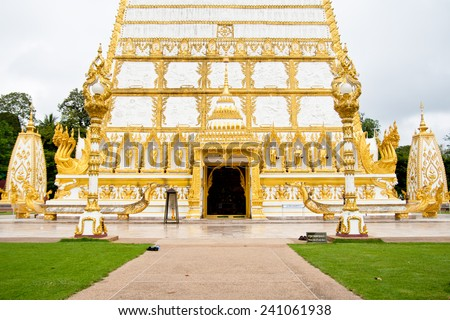 Ornament: architecture landscape of white and gold pagoda at wat Phrathat Nong Bua in Ubon Ratchathani province, Thailand  - stock photo