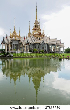 Ornament: beautiful of White Thai Temple near the pond with reflection at Sorapong's Temple in Nakhon Ratchasima Province, Thailand