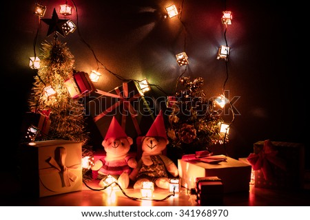 Ornament Christmas decorate at Merry Christmas night light. Christmas tree and other decoration with Lovely bear, a gift,  and ribbon .