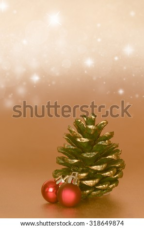 Ornament  Christmas with red ball and pine cone over gold background - stock photo