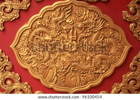 Ornament  golden dragon decorated on red wall - stock photo