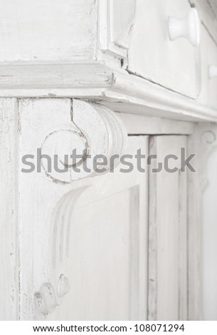 Ornament of a vintage cupboard, close up with selective focus - stock photo