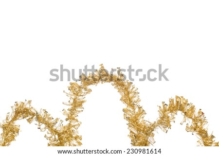 Ornament of gold tinsel. Isolated on the white background. - stock photo