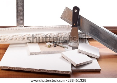 Ornament of plaster,spatula, tin profile, drywall on a white background