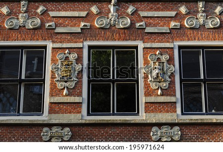 Ornament on a historic building in the center of Enkhuizen, Netherlands - stock photo