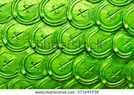 Ornament Texture Background. Asian ( Thai ) Traditional Art Design Pattern, Green Sculpture Of Dragon Squama Or Skin In Buddhist Temple. Details, Elements Of Pagoda. Thailand Architecture. - stock photo