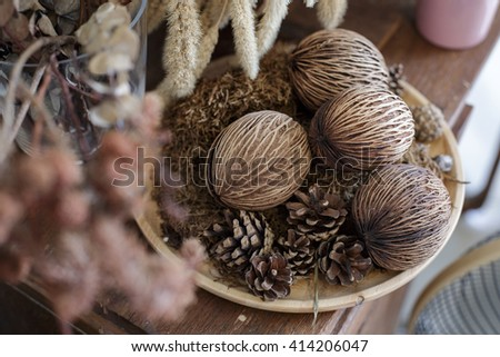 ornament with dried flowers on the wooden table