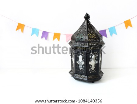 Top Moroccan Table Eid Al-Fitr Decorations - stock-photo-ornamental-dark-moroccan-arabic-lantern-on-the-white-table-party-decoration-string-of-colorful-1084140356  Image_93934 .jpg