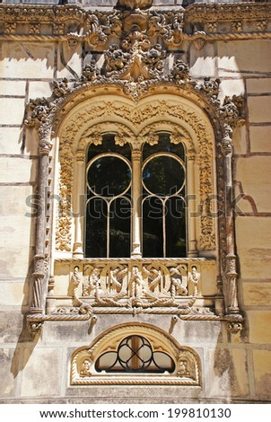 Ornamental manueline style window in Regaleira Palace, Sintra, Portugal. Manueline is Portuguese style of architectural ornamentation of first decades of 16th century incorporating maritime elements. - stock photo