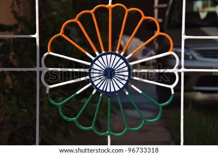 Ornamental metal lattice in indian flag colors - stock photo