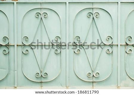 ornamental work of iron door - stock photo