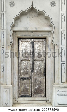 ornamented door in a city named Amritsar in India - stock photo