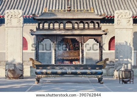 Ornate black iron altar at a Taoist temple, Beijing, China - stock photo