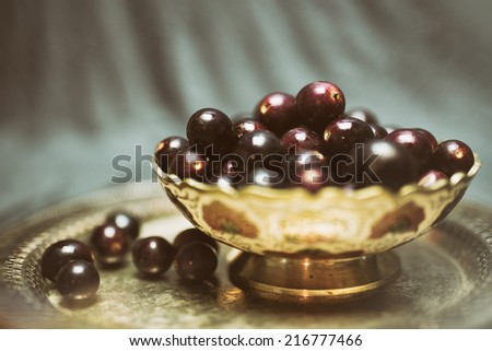 ornate bowl filled red muscadine grapes stock photo royalty free