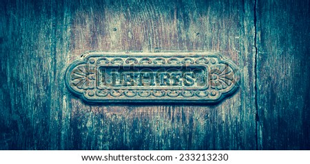 """Ornate brass letterbox with inscription LETTRES (""""Letters"""" in French). Tours, France. Aged photo. - stock photo"""