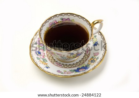 ornate china cup of coffee on a white background
