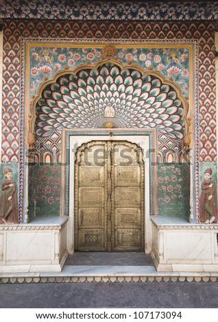 Ornate door in Chandra Mahal - Cipty Planase in Jaipur, Rajastan, India - stock photo