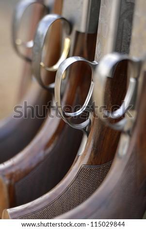 Ornate engraving on the stock of a shotgun - stock photo