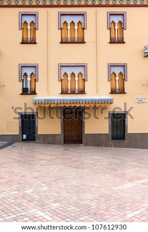Ornate facade of a traditional house on the Plaza del Triunfo in Cordoba, Andalusia, Spain. - stock photo