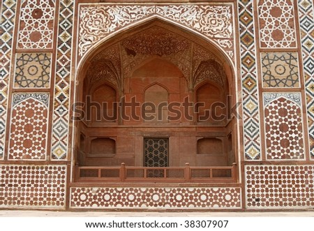 Ornate facade of Akbar's Tomb (the great Mughal emperor). Islamic style architecture. Red sandstone inlaid with  white marble. Sikandra, Agra, India