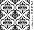 Ornate floral arabesque decorative seamless pattern with each motif in a foliate frame suitable for textiles and damask style fabric. Vector version also available in gallery - stock photo