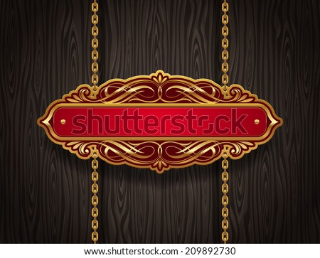 Ornate gold vintage signboard hanging on chains against a wooden wall - stock photo