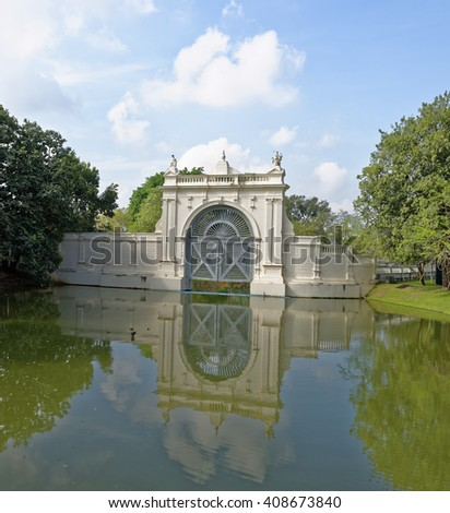 Ornate lake gate structure in the grounds of the Bang Pa-In royal summer palace near Ayutthaya, Thailand - stock photo