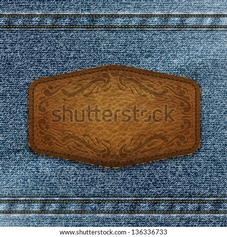 Ornate leather label with copyspace on denim background  - raster version