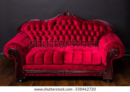 Ornate luxury antique red love seat couch - stock photo