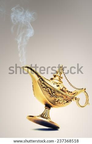 Ornate Magic lamp of Aladdin - stock photo