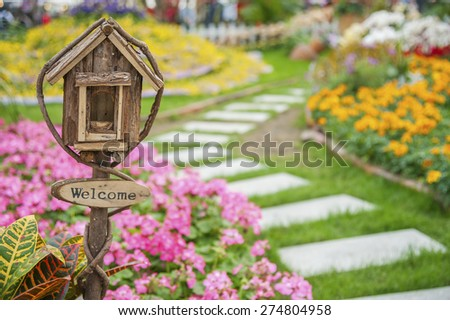 Ornate Mailbox in colorful garden - stock photo