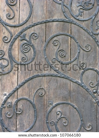 Ornate patterned iron medieval door - stock photo