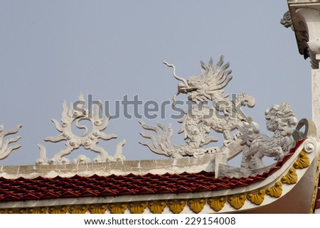 Ornate rooftop of a Chinese Buddhist temple  - stock photo