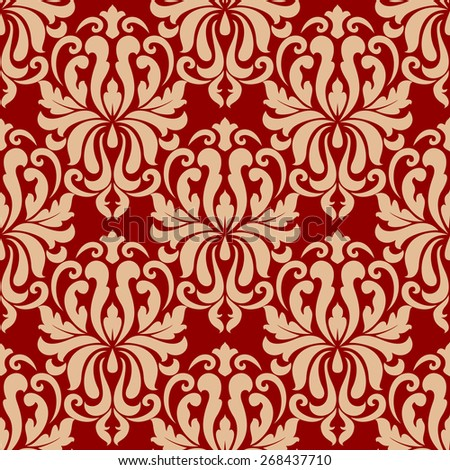 Ornate seamless arabesque repeat pattern on red background with densely packed floral motifs in beige suitable for textiles and wallpaper - stock photo