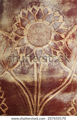 Ornate sunflower carving on wooden board - stock photo