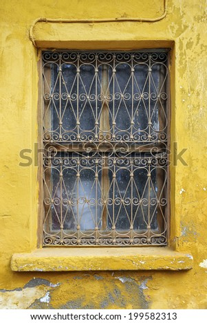 Ornate window detail on yellow building in Antalya,Turkey
