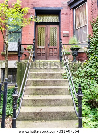 ornate wood door of an upscale home on a upscale wealthy neighbourhood - stock photo