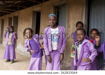 OROMIA, ETHIOPIA-APRIL 21, 2015: Unidentified students take a break from class in a rural region of Ethiopia - stock photo
