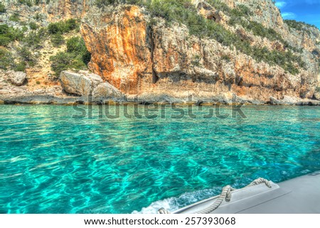 Orosei Gulf seen from the water in hdr tone mapping effect - stock photo