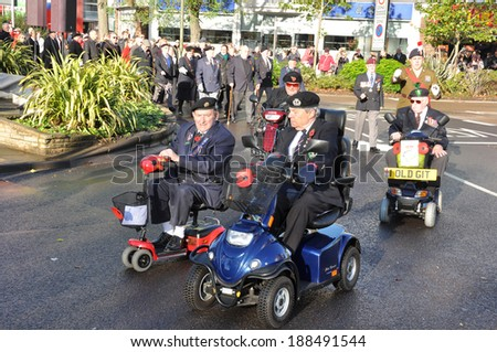 ORPINGTON,KENT,UK- 12 November 2013: Veterans take part in the Remembrance day (also known as Poppy Day and Armed Forces Day)  Parade on the main street of Orpington, Kent on the 12 November 2013  - stock photo